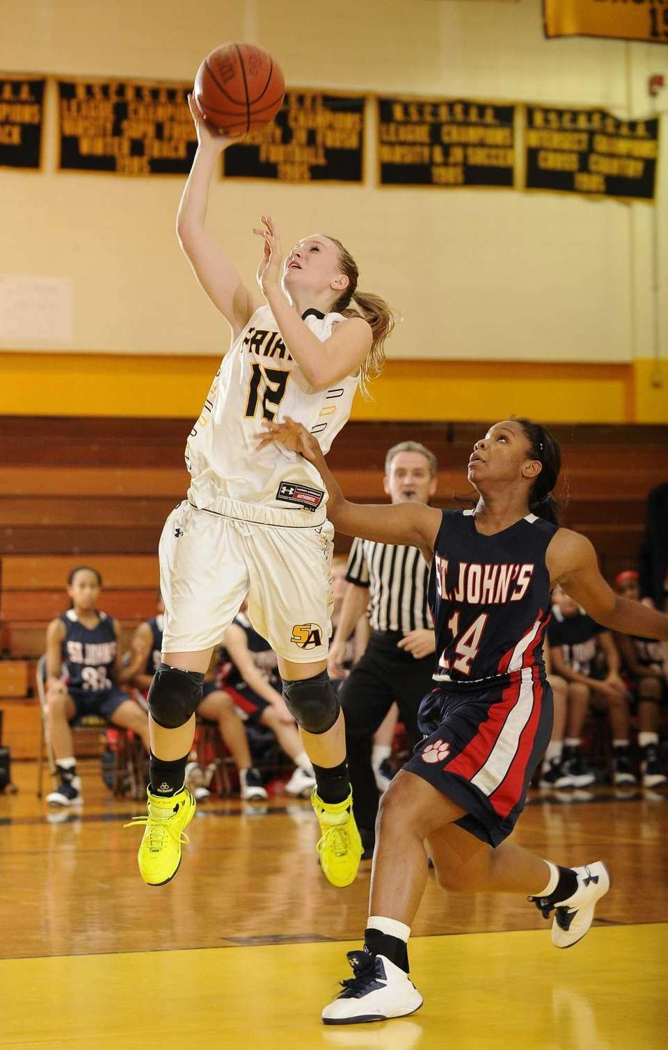 St. Anthony's guard Rebecca Musgrove is fouled by