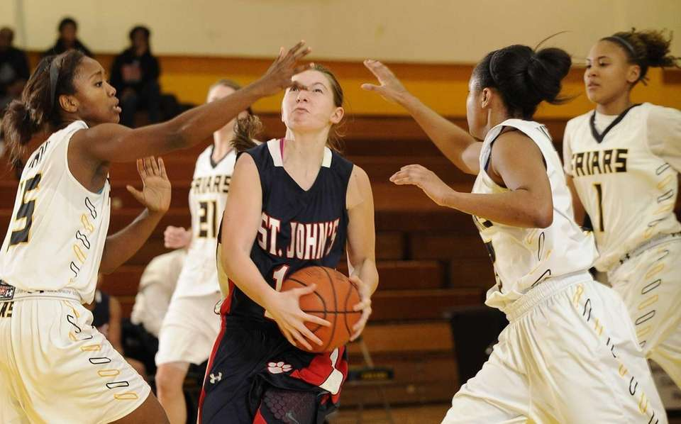 St. John the Baptist's Sydney Zambrotta is guarded