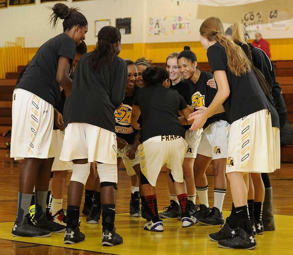 St. Anthony's players gather together on the court