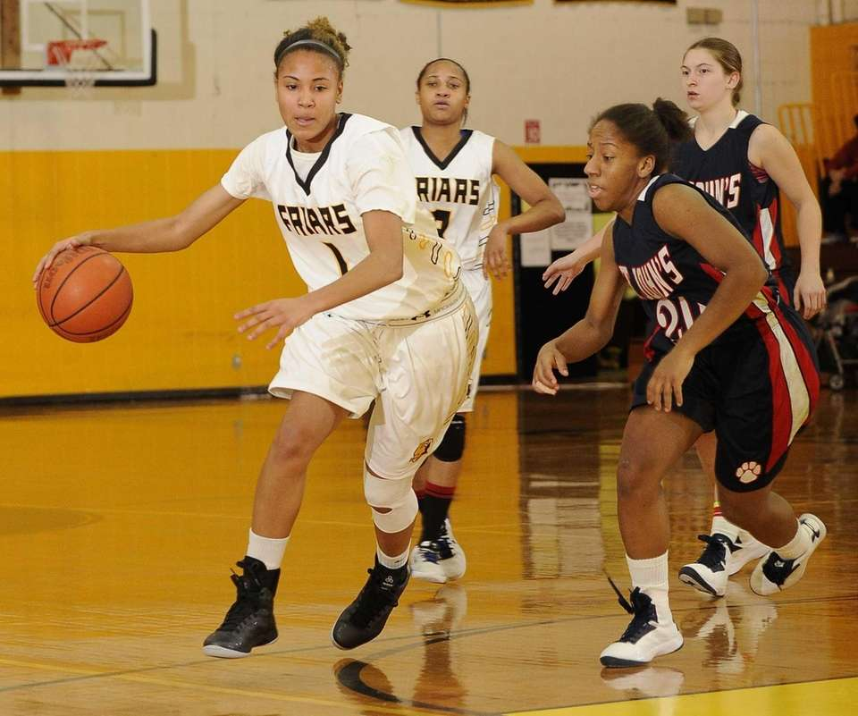 St. Anthony's guard Chastity Taylor dribbles past St.