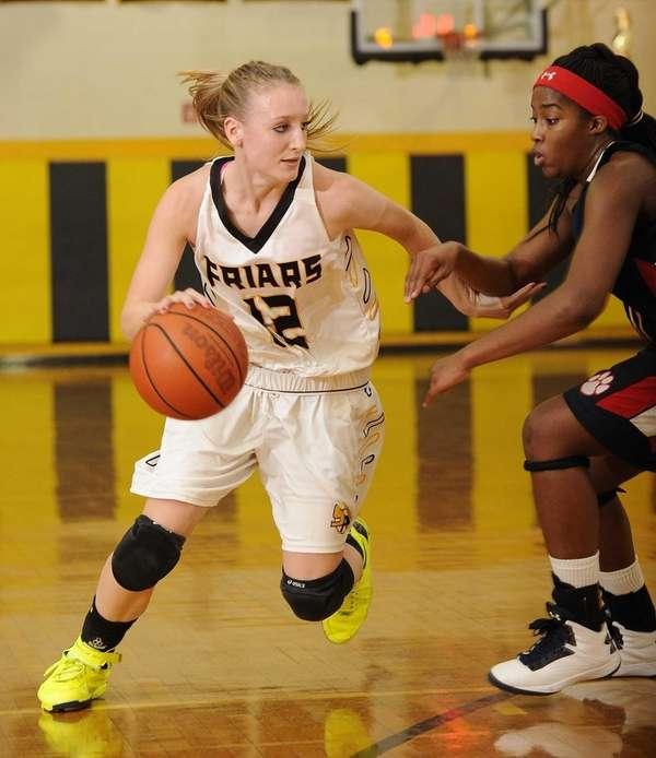 St. Anthony's guard Rebecca Musgrove drives around St.