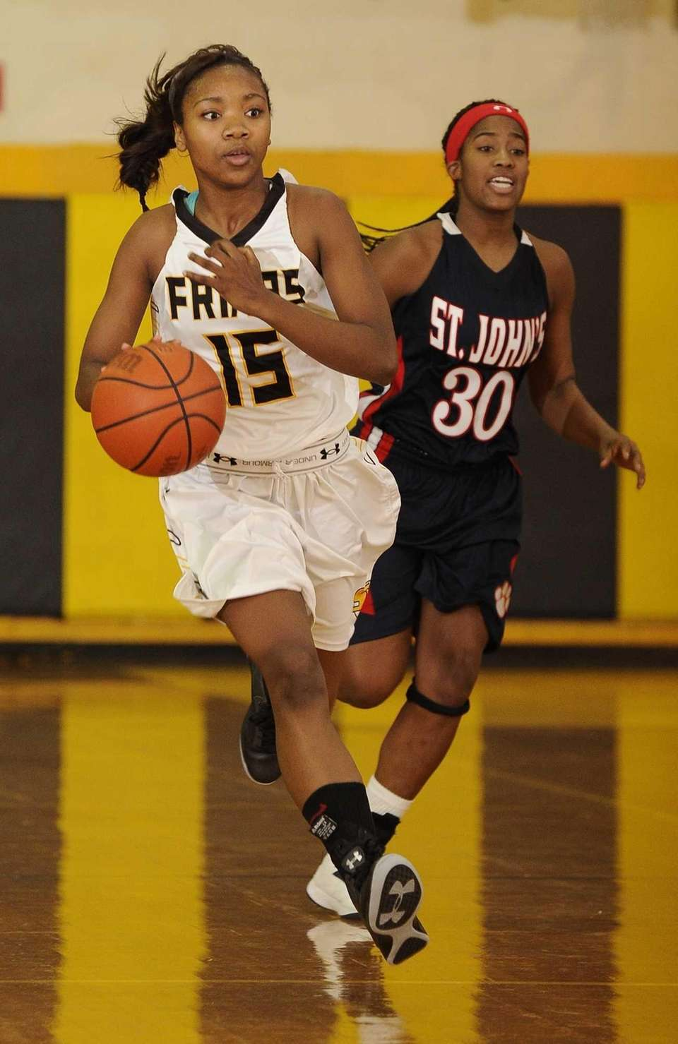 St. Anthony's forward Kalifa Davy dribbles the ball