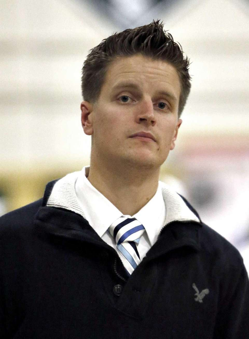 Lindenhurst boys varsity basketball head coach Brett Kearney