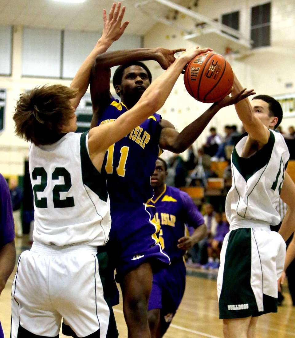 Central Islip's Ishiah Booker draws the foul while