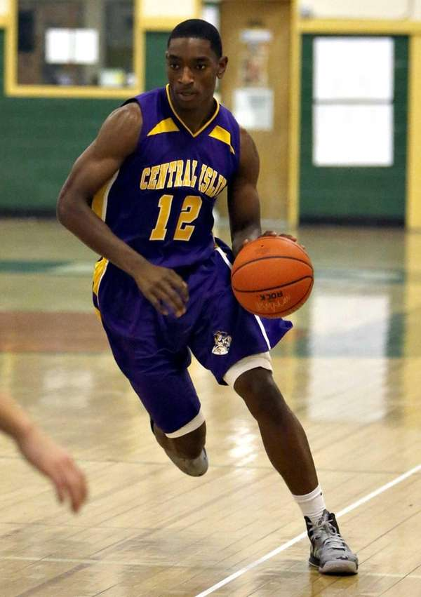 Central Islip's Tim McKenzie drives upcourt on a