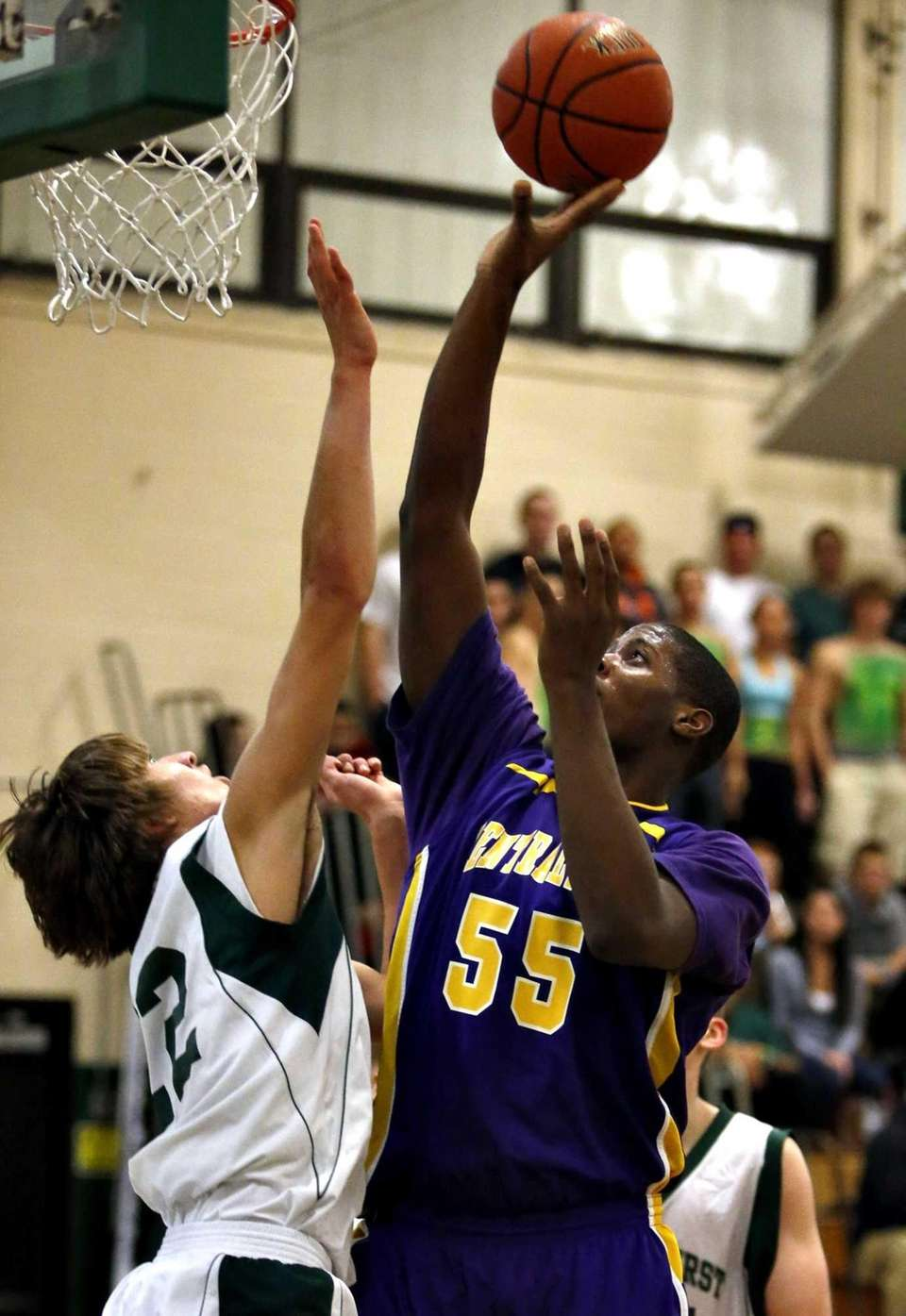 Central Islip's Malcolm Pridgeon attempts a shot over