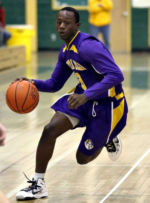 Central Islip's David McKenzie brings the ball upcourt.