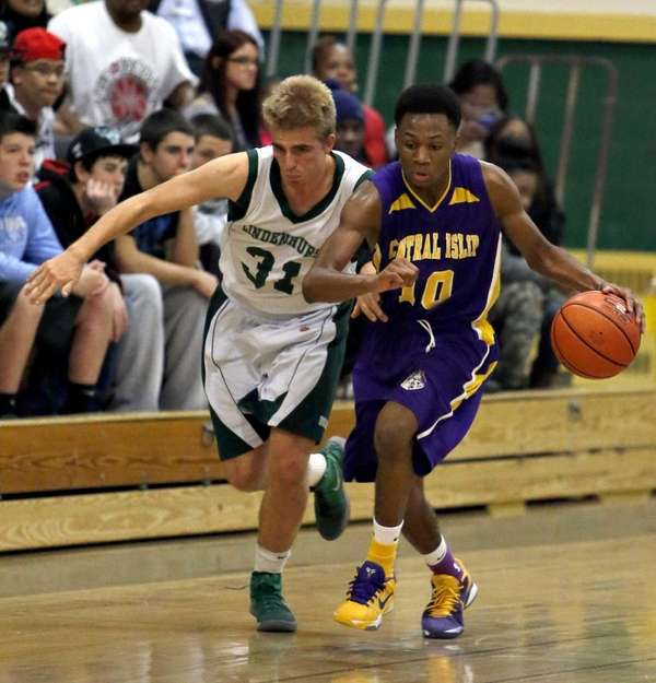 Central Islip's Corey Pepe tries to drive past