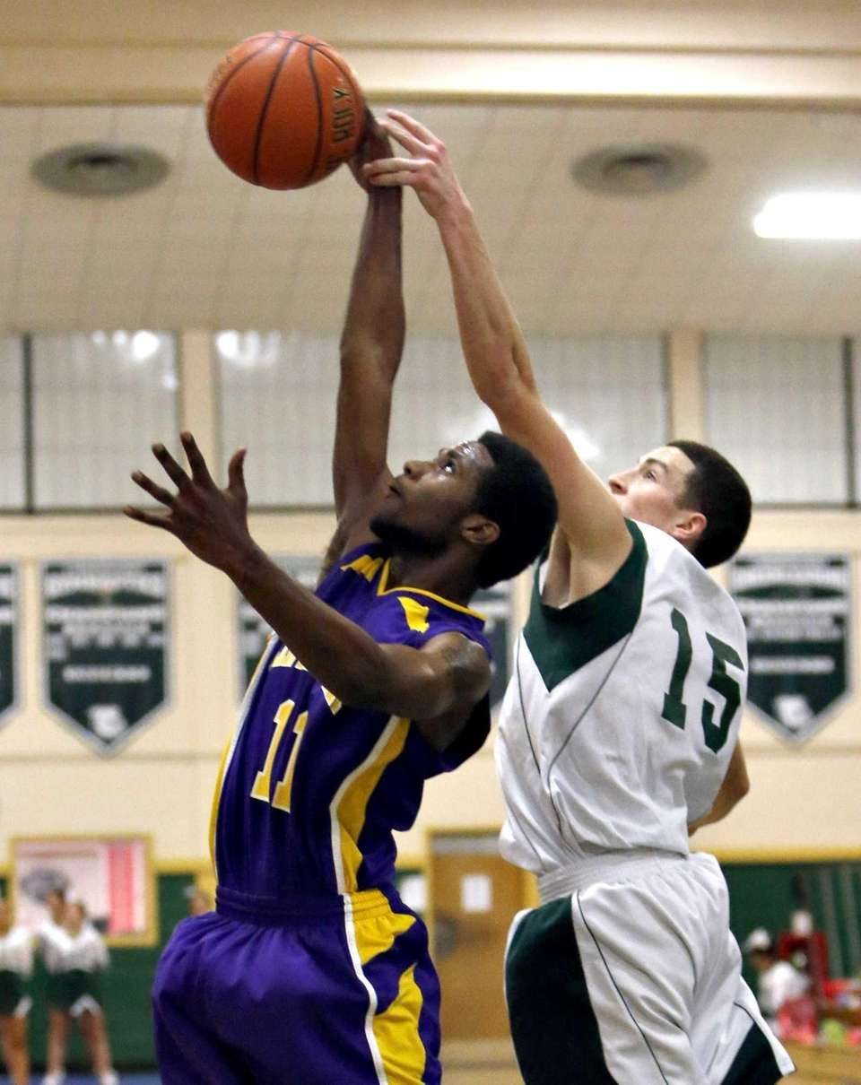 Central Islip's Ishiah Booker pulls down the defensive