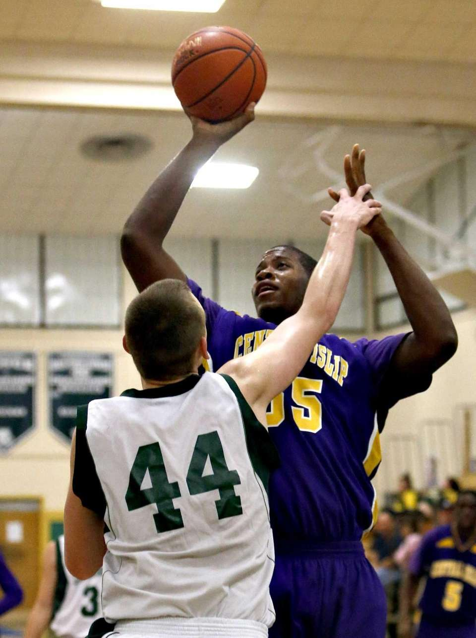 Central Islip's Malcolm Pridgeon is fouled by Lindenhurst's