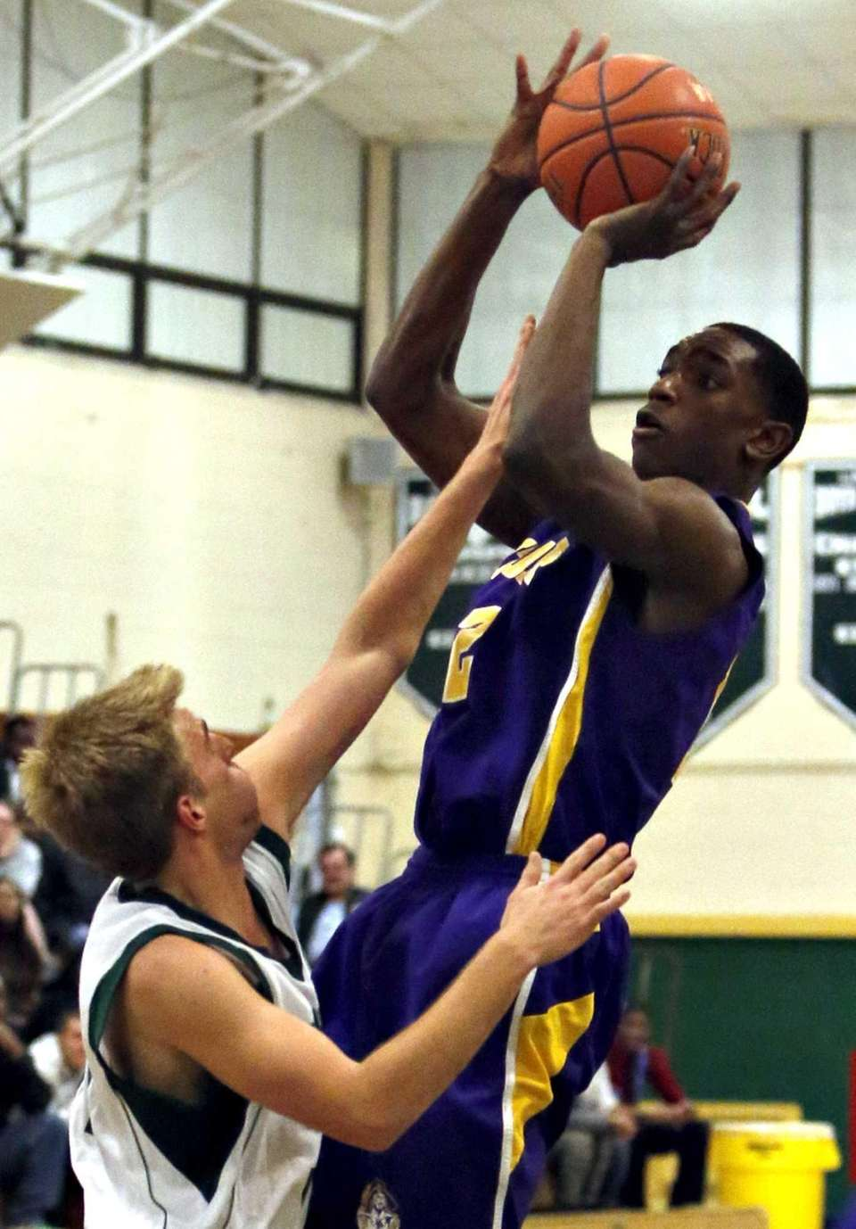 Central Islip's Tim McKenzie attempts a pull-up jumper