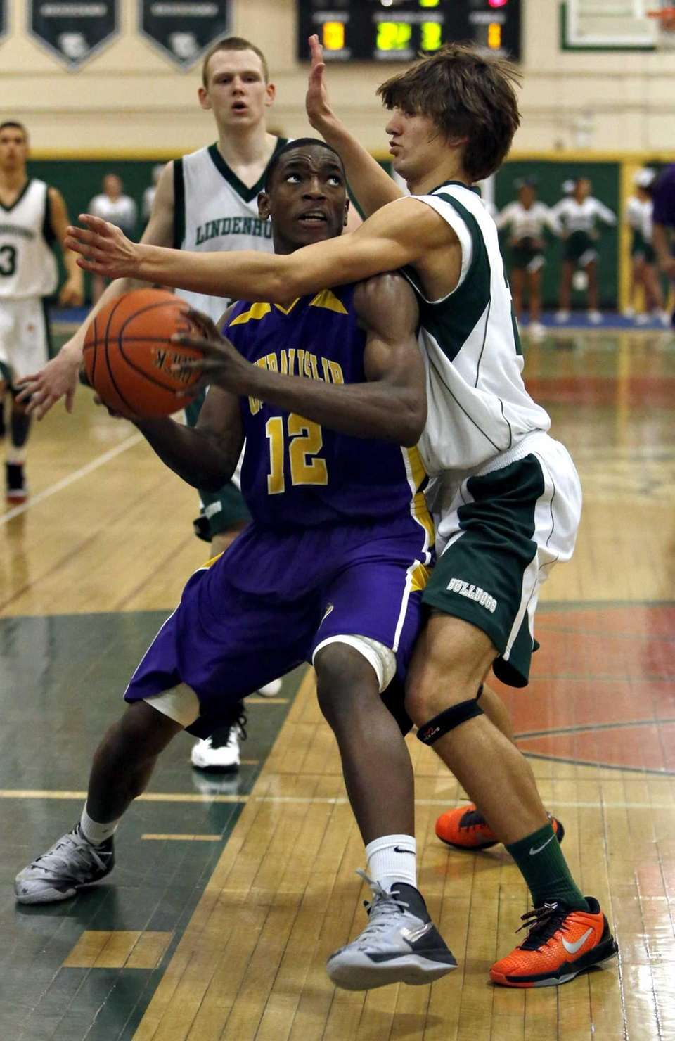 Central Islip's Tm McKenzie is fouled in the