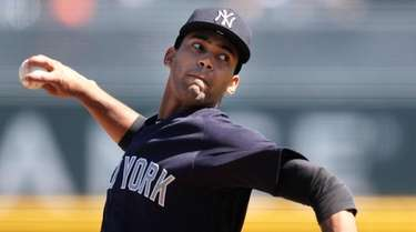 Yankees starting pitcher Deivi Garcia works against the