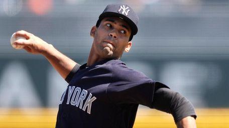 Yankees starting pitcher Deivi Garcia works against the