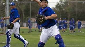 Toronto Blue Jays catcher Travis d'Arnaud, right, makes