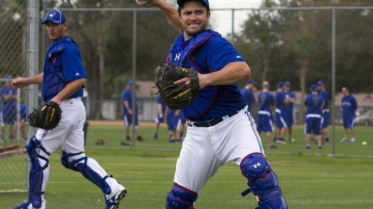Toronto Blue Jays catcher Travis d'Arnaud, right, makes