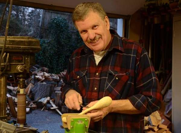 Don Dailey, 60, of Huntington Station, carves a