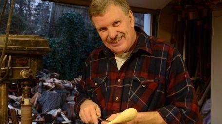 Don Dailey, 60, of Huntington Station, carves a