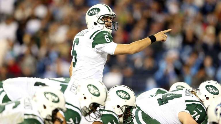 Mark Sanchez calls a play before he snaps