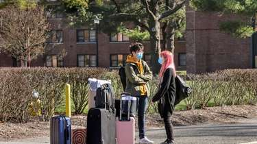 Two Stony Brook University students wait to be