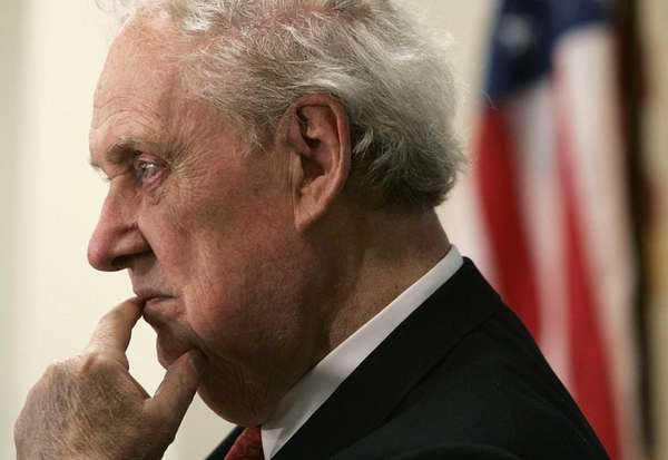 Former Supreme Court nominee Robert Bork listens during