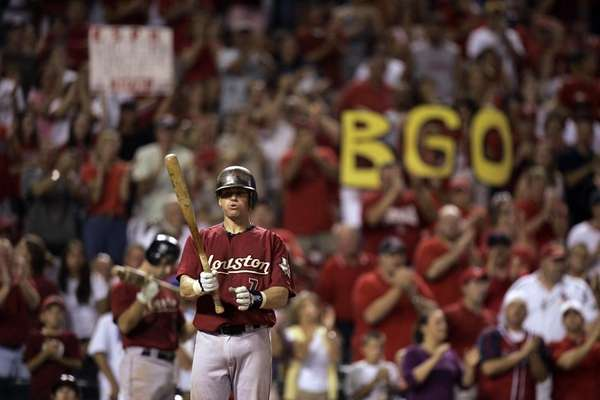 Fans cheer Houston Astros' Craig Biggio during his