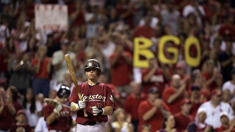 Fans cheer Houston Astros' Craig Biggio during his