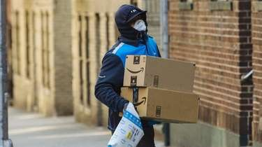 A worker wearing a protective mask and gloves