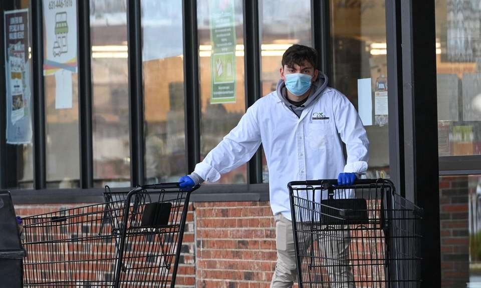A worker wearing a mask and gloves outside