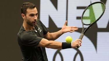 Noah Rubin returns the ball during a New