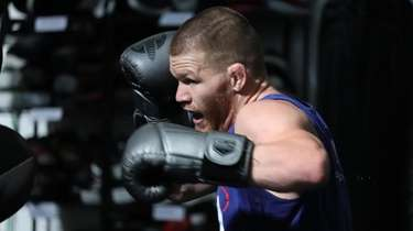 Huntington's Matt Frevola hits pads on Oct. 25,