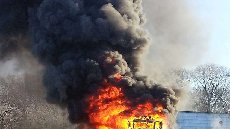 A tractor trailer and a car are engulfed