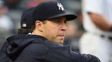 Former Yankees first baseman Mark Teixeira looks on