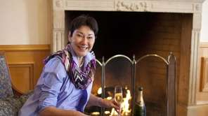 CEO and winemaker Eileen Crane sits with a