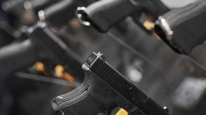 A Glock 29 10-mm pistol hangs on display
