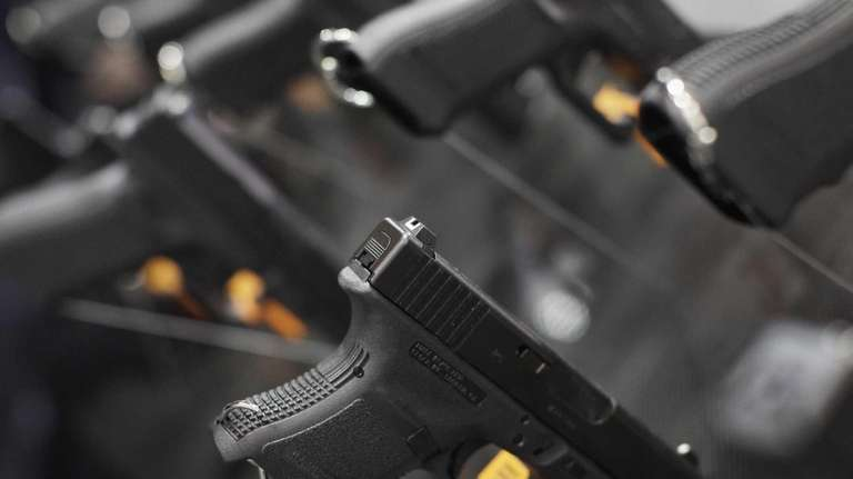 Letter pistol permit checks curb misuse newsday a glock 29 10 mm pistol hangs on display altavistaventures Gallery