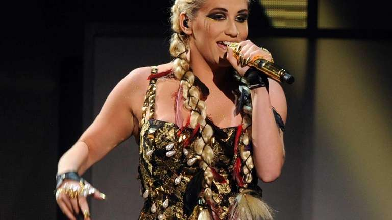 Kesha performs during the 40th American Music Awards