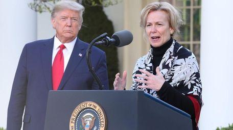 President Donald Trump listens to Dr. Deborah Birx,