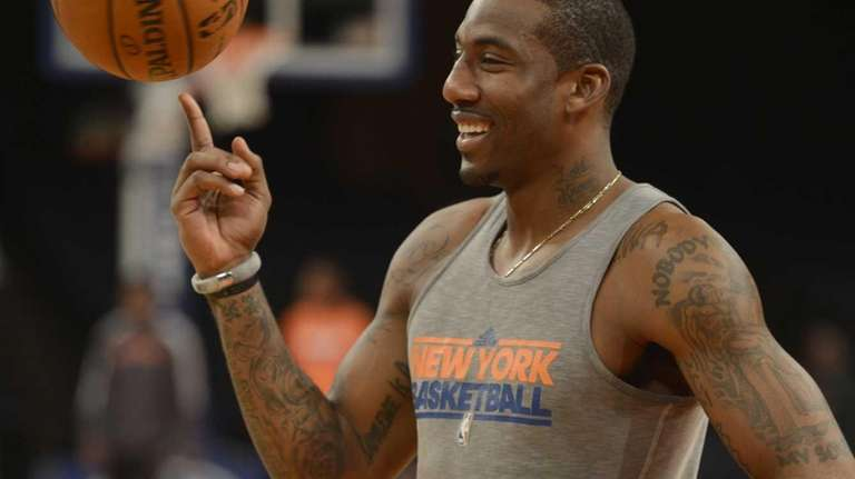 Amar'e Stoudemire spins a ball on his finger