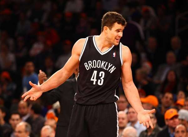Kris Humphries argues a technical foul called against