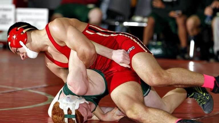 Sachem East's Anthony Messina rolls William Floyd's Steve