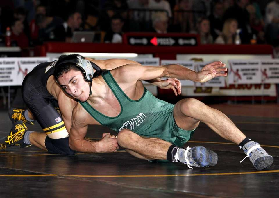 Brentwood's Kevin Rivas escapes the grasp of Sachem