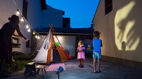 A home's backyard doubles as a campsite in