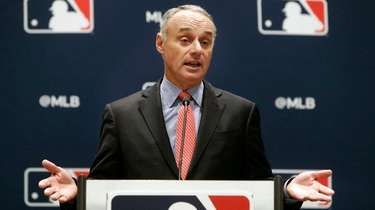 MLB commissioner Rob Manfred speaks to the media