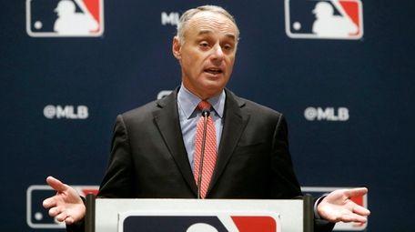 MLB commissioner Rob Manfred speaks to the media