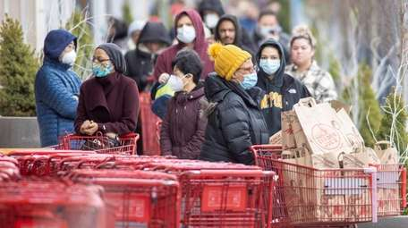 Shoppers line up outside Trader Joe's on Tuesday