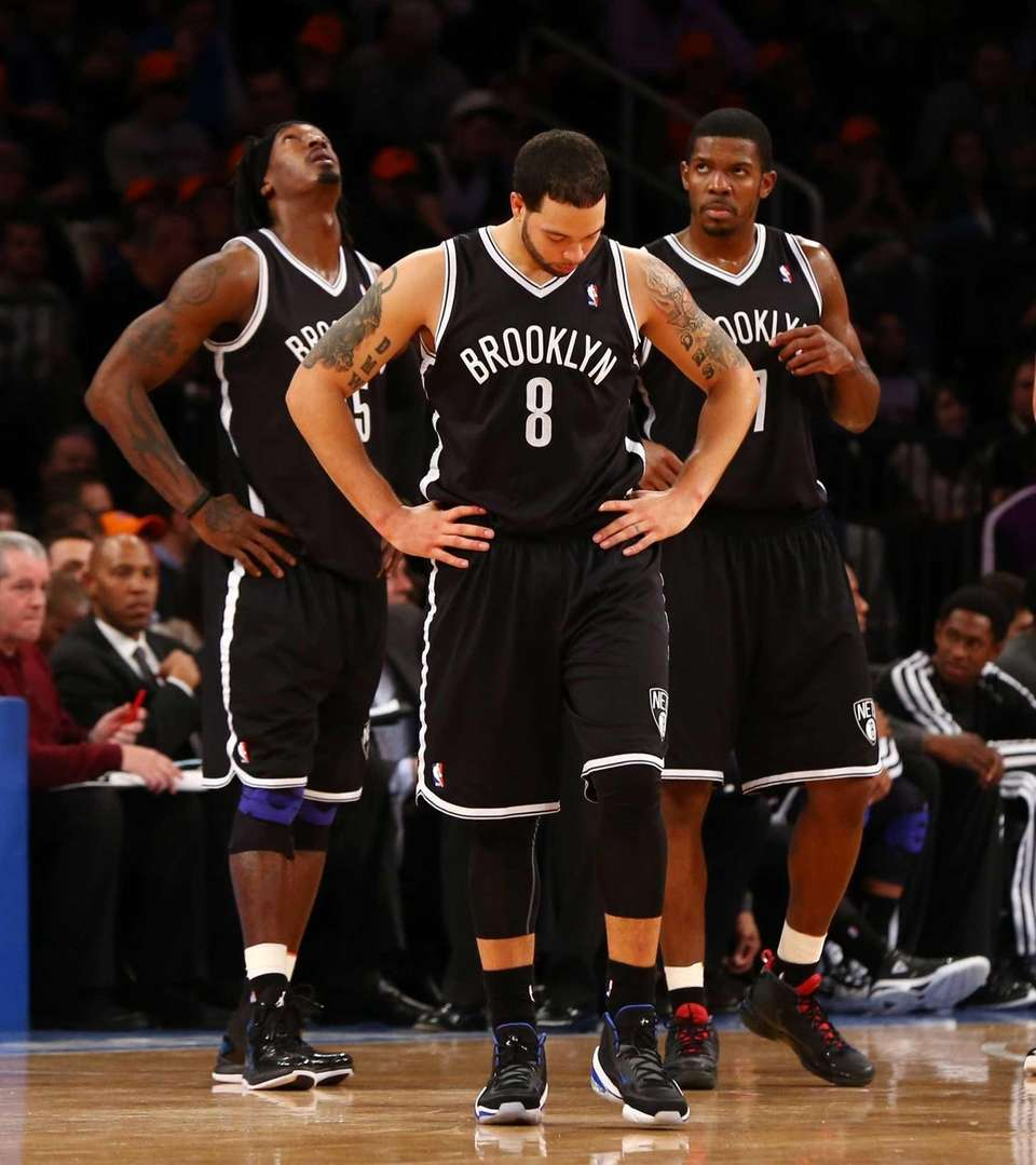 Deron Williams looks on in the second half