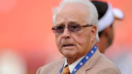 Dr. James Andrews stands on the field before