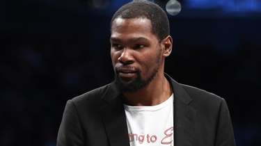 The Nets' Kevin Durant looks on in the