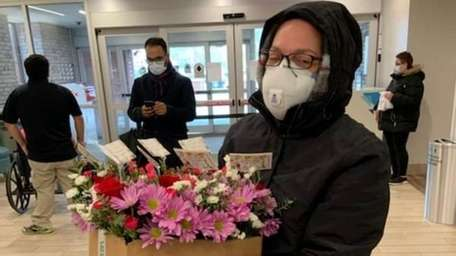 Jeanine Amato delivers flowers to Southside Hospital in